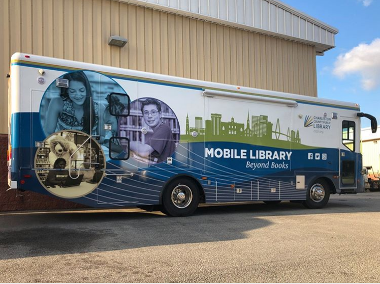 Bus with library decals on it