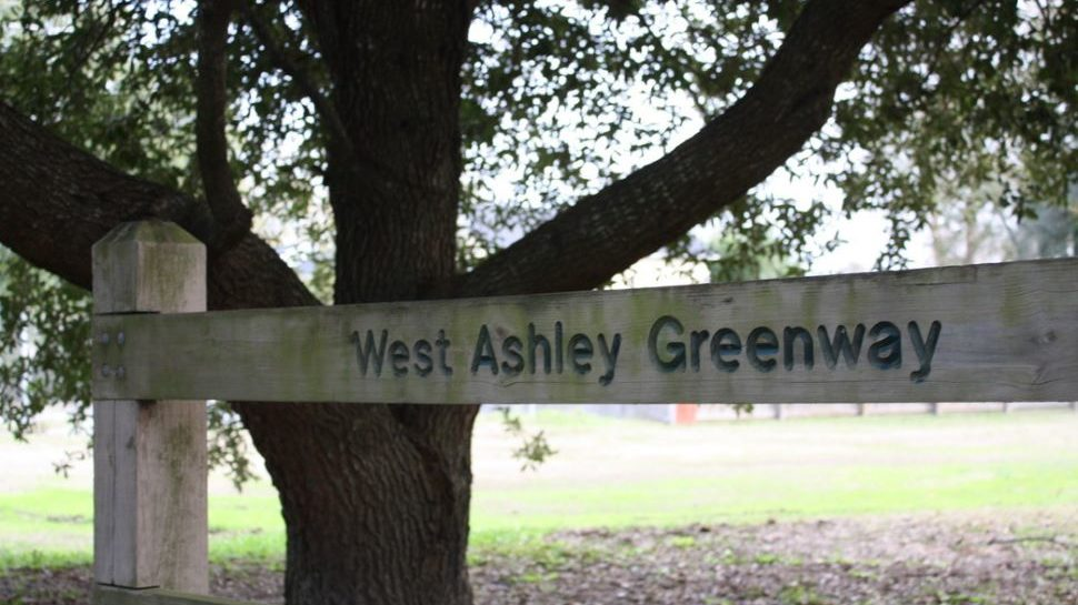 """Fence that says """"West Ashley Greenway"""""""